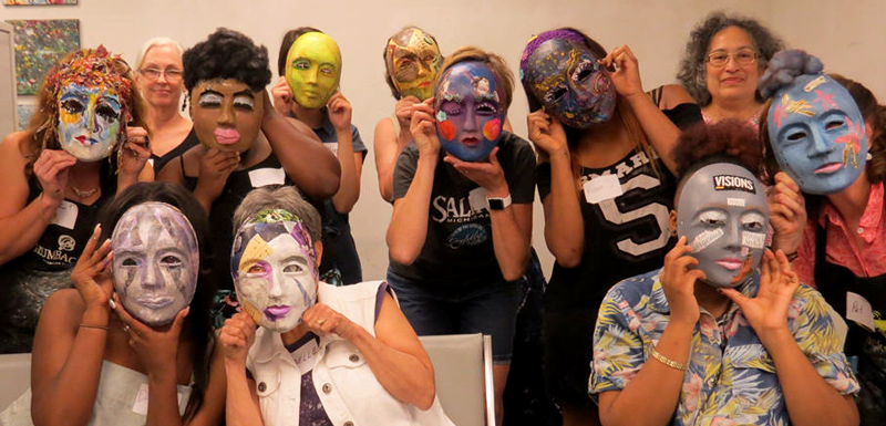Members of Girls' Group and AAWA artists model their portrait faces for the camera.