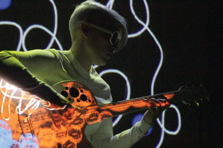 Kaki King performed on a specially made projection guitar. Photo by Randy Gunter.