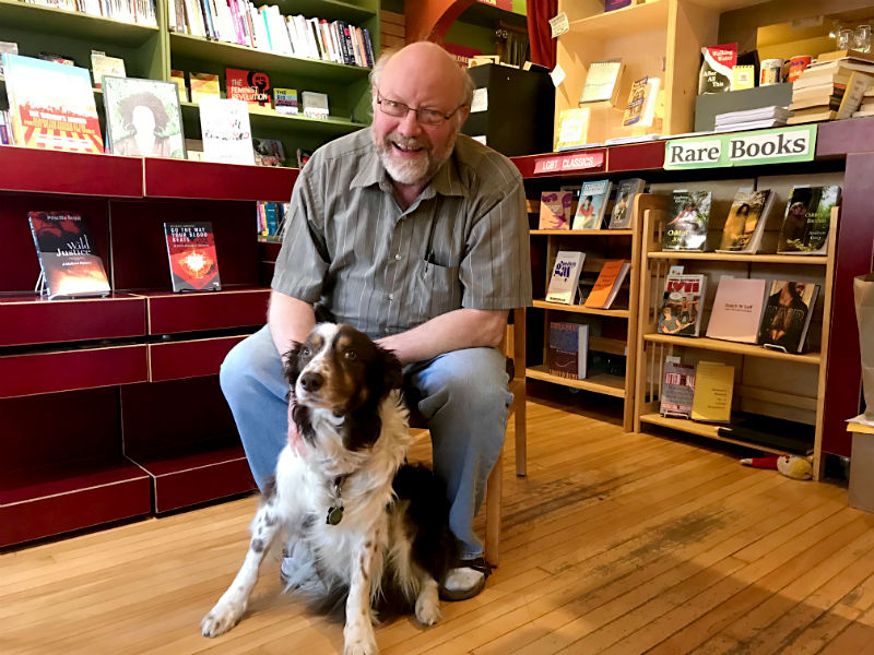 Common Language bookstore co-owner Keith Orr with store pup Duke