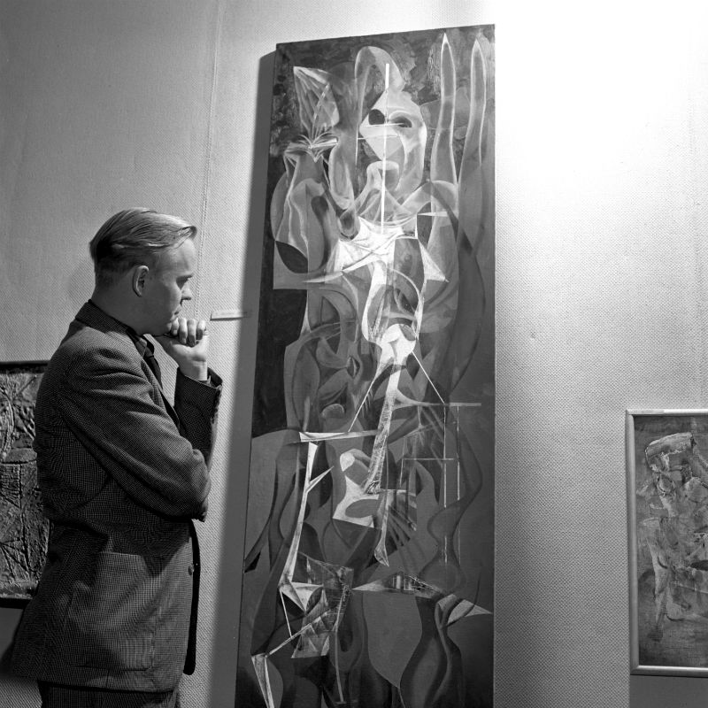 Gerome Kamrowski with one of his paintings in the Rackham Building, January 1951